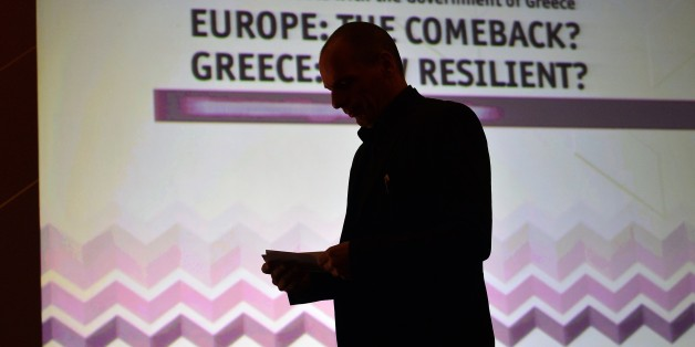 Greek finance minister Yianis Varoufakis stands prior to deliver a speech  during the Economist conference entitled  'Europe: The comeback ? Greece: How resilient?' on May 14, 2015 in Athens.  Greece wants the European Central Bank to agree for Athens to delay payment on some 27 billion euros ($30 billion) in Greek bonds that it will otherwise be unable to repay, the finance minister said . AFP PHOTO/ LOUISA GOULIAMAKI         (Photo credit should read LOUISA GOULIAMAKI/AFP/Getty Images)