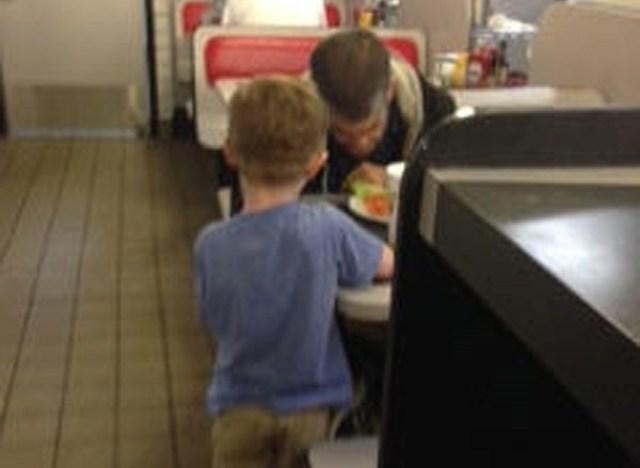 kid helps homeless guy