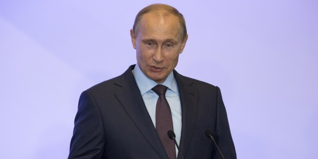 Russian President Vladimir Putin addresses members of Russian State duma fractions during a meeting in Mria sanatorium near Yalta, Crimea, on August 14, 2014. President Vladimir Putin said on Thursday that Russia should not 'fence itself off from the outside world' despite a plunge in East-West relations over the pro-Kremlin insurgency in Ukraine. AFP PHOTO / POOL / ALEXANDER ZEMLIANICHENKO        (Photo credit should read ALEXANDER ZEMLIANICHENKO/AFP/Getty Images)