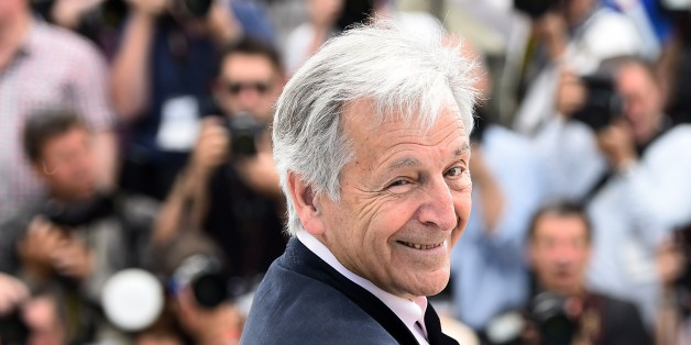 Greek director Costa-Gavras smiles during a photocall for the sidebar section 'Cannes Classics' at the 68th Cannes Film Festival in Cannes, southeastern France, on May 18, 2015.      AFP PHOTO / ANNE-CHRISTINE POUJOULAT        (Photo credit should read ANNE-CHRISTINE POUJOULAT/AFP/Getty Images)
