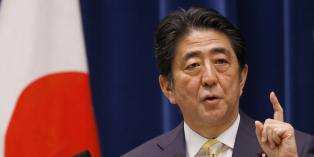 Japan's Prime Minister Shinzo Abe speaks during a press conference at his official residence in Tokyo, Thursday, May 14, 2015. Japan's Cabinet endorsed a set of defense bills Thursday that would allow the country's military to go beyond its self-defense stance and play a greater role internationally, a plan that has split public opinion. (AP Photo/Shizuo Kambayashi)