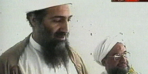 "This image taken from video released by Qatar's Al-Jazeera televison broadcast on Friday Oct. 5, 2001 is said to show Osama bin Laden, the prime suspect in the Sept. 11, 2001 terrorist attacks on the United States, at an undisclosed location. Al-Jazeera did not say whether the image was taken before or after the Sept. 11 attacks or how they obtained it. At right is bin Laden's top lieutenant, Egyptian Ayman al-Zawahri. Bin Laden is believed to have been at a celebration of the union of his al-Qaida network and al-Zawahri's Egyptian Jihad group. Graphic at top right reads ""Exclusive to Al-Jazeera."" At bottom right is the station's logo which reads ""Al-Jazeera."" (AP Photo/Al-Jazeera via APTN)"