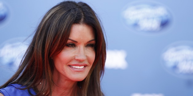 """Janice Dickinson arrives at the """"American Idol"""" finale on Wednesday, May 25, 2011, in Los Angeles. (AP Photo/Matt Sayles)"""