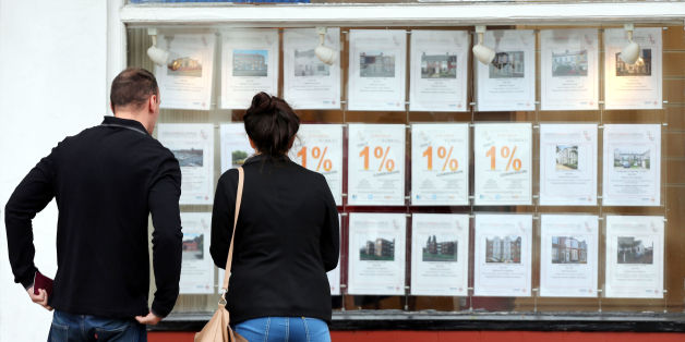 Embargoed to 0001 Tuesday January 6 File photo dated 08/10/13 of a couple looking at houses for sale in a estate agents window. The number of first-time buyers climbing onto the property ladder jumped by more than a fifth last year to stand at a seven-year high, figures today revealed.