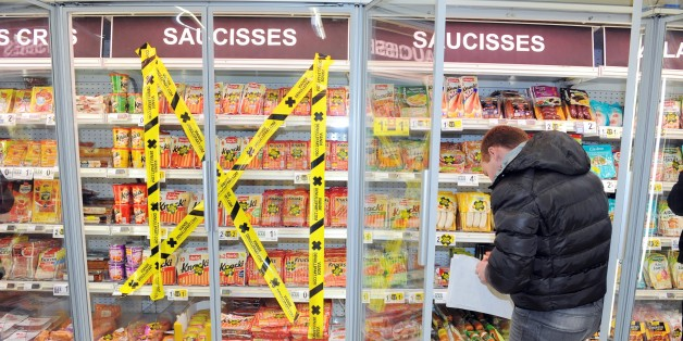 Tape is stuck across a cold fridge selling packets of meat at a super market in Quimper, western of France on February 7, 2015, to make customers aware about the origin of the meat they are buying, as consumers are growing more and more concerned with the origin and the fabrication process of what they eat. AFP PHOTO FRED TANNEAU        (Photo credit should read FRED TANNEAU/AFP/Getty Images)