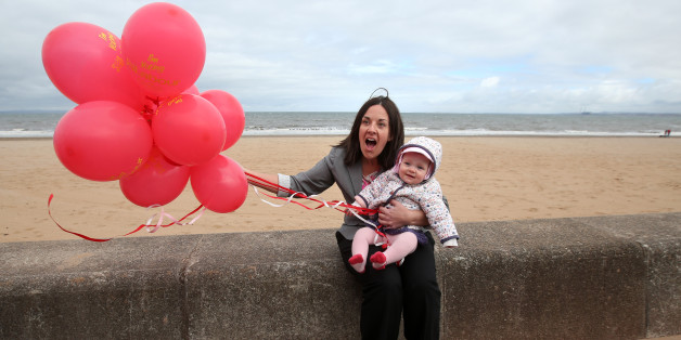 Scottish Labour Deputy Leader Kezia Dugdale with seven month old Sadie Chambers from Edinburgh at Portobello beach whilst on the General Election campaign trail.