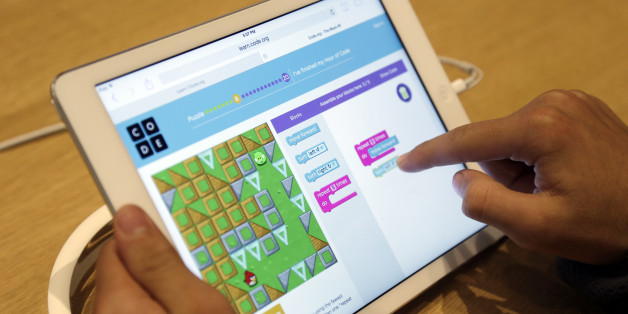Matthew Triska, 13, learns to build code using an iPad at a youth workshop at the Apple store on Wednesday, Dec. 11, 2013, in Stanford, Calif. Apple stores nationwide were participating in computer science education week Wednesday, part of a joint effort with code.org to teach children the basics of coding. (AP Photo/Marcio Jose Sanchez)