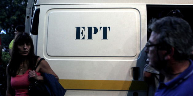 A woman stands in front of a van of the Greek state television ERT headquarters on June 16, 2013 in Athens. European Broadcasting Union (EBU) asked Greece to re-open public broadcaster ERT after the government's surprise decision to pull it off the air in a bid to cut spending sparked a nationwide strike. Greek Prime Minister Antonis Samaras on June 14 offered to partially reinstate state broadcaster ERT after a backlash over its dramatic closure threatened to derail his government. AFP PHOTO / ANGELOS TZORTZINIS        (Photo credit should read ANGELOS TZORTZINIS/AFP/Getty Images)