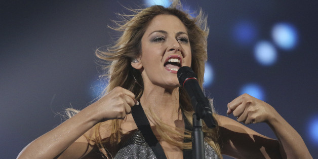 Maria Elena Kyriakou representing Greece performs the song 'One Last Breath' on stage during a dress rehearsal for the final of the Eurovision Song Contest in Austria's capital Vienna, Friday, May 22, 2015. (AP Photo/Ronald Zak)