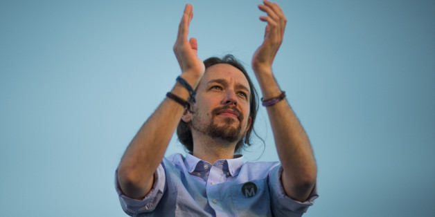 Pablo Iglesias, the leader of Spain's new and growing left wing 'Podemos' (We Can) party, salutes the crowd during a meeting with supporters for the upcoming local elections in Madrid, Spain, Friday, May 22, 2015. Spain could be set for a political upheaval in key local elections this weekend, with strong signs that voters fed up with economic crisis and corruption scandals may punish both the ruling conservative Popular Party and the leading opposition Socialists. (AP Photo/Andres Kudacki)