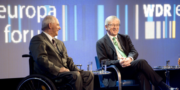 German finance minister Wolfgang Schaeuble (L) and prime minister of Luxemburg Jean-Claude Juncker (R) take part in a panel discussion during the WDR (West Deutche Rundfunk) Europe forum conference at the foreign ministry in Berlin on May 16, 2013. AFP PHOTO / ODD ANDERSEN        (Photo credit should read ODD ANDERSEN/AFP/Getty Images)