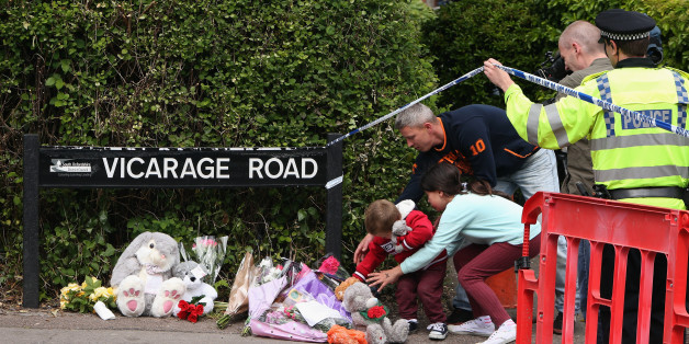 DIDCOT, ENGLAND - MAY 25:  Members of the public lay tributes near the home of three people who were found dead at their home, on May 25, 2015 in Didcot, England. Janet Jordon, 48, her six-year-old daughter Derin and Philip Howard, 44, were found dead at their home in Didcot on May 23, 2015. The hunt for Jed Allen, the man suspected of killing the three has entered its second day.  (Photo by Dan Kitwood/Getty Images)