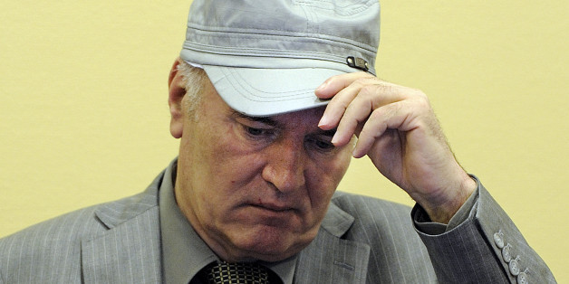 """FILE - In this June 3, 2011 file photo, former Bosnian Serb Gen. Ratko Mladic removes his hat in the court room during his initial appearance at the U.N.'s Yugoslav war crimes tribunal in The Hague, Netherlands. Former Bosnian Serb military chief Ratko Mladic was hospitalized Thursday July 12, 2012 after complaining of feeling unwell at his genocide trial. Mladic was checked by a nurse at the tribunal after feeling ill and then sent to hospital """"as a precautionary measure,"""" Yugoslav war crimes t"""