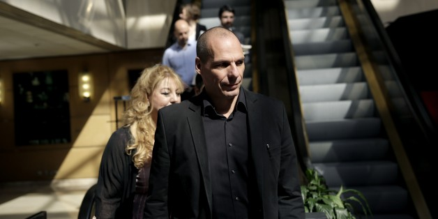 Greek Finance Minister Yanis Varoufakis, right, arrives at an economic conference in Athens, on Tuesday, May 14, 2015. Varoufakis said Thursday that he will reject any deal with bailout creditors unless it helps Greece escape from its financial crisis. (AP Photo/Petros Giannakouris)