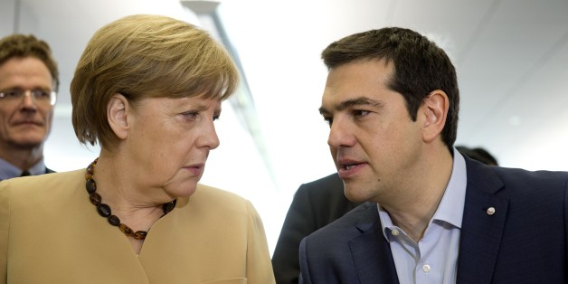 German chancellor Angela Merkel (L) talks with Greek prime minister Alexis Tsipras at the begining of the second day of  the fourth European Union (EU) eastern Partnership Summit in Riga, on May 22, 2015 as Latvia holds the rotating presidency of the EU Council. EU leaders and their counterparts from Ukraine and five ex-Soviet states hold a summit focused on bolstering their ties, an initiative that has been undermined by Russia's intervention in Ukraine. AFP PHOTO ALAIN JOCARD        (Photo cre
