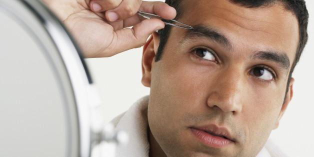 Hispanic man tweezing eyebrows
