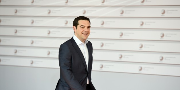 Greek Prime Minister Alexis Tsipras arrives at the House of the Blackhead for an informal dinner at the start of the fourth European Union (EU) eastern Partnership Summit in Riga, on May 21, 2015 as Latvia holds the rotating presidency of the EU Council. EU leaders and their counterparts from Ukraine and five ex-Soviet states hold a summit focused on bolstering their ties, an initiative that has been undermined by Russia's intervention in Ukraine.  AFP PHOTO / ALAIN JOCARD        (Photo credit s