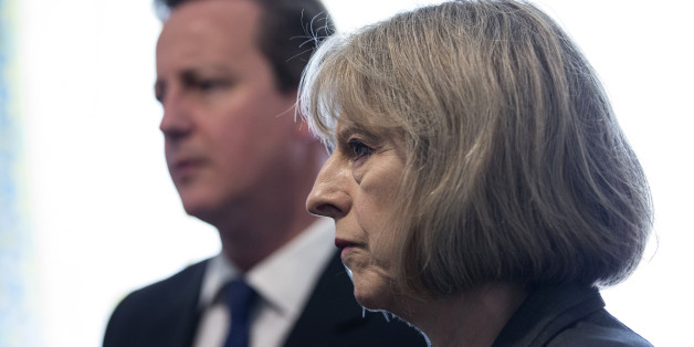 Prime Minster David Cameron and Home Secretary Theresa May speak to Home Office Immigration Enforcement officers at a property where six immigrants were arrested in Slough, Berkshire.
