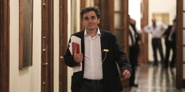 Euclid Tsakalotos, Greece's Deputy Foreign Minister for international economic relations  arrives for a cabinet meeting at the parliament in Athens, Greece, on Thursday, April 30, 2015. Greece's started a new round of talks with bailout negotiators Thursday, insisting it was not ready to make key concessions despite a major looming debt repayment.  (AP Photo/Yorgos Karahalis)