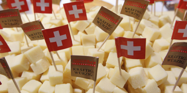 BERLIN, GERMANY - JANUARY 21:  Swiss flags stick out of cubes ofAppenzeller Swiss cheese at a stand at the 2011 Gruene Woche agricultural trade fair at Messe Berlin on January 21, 2011 in Berlin, Germany. The trade fair comes on the heels of a dioxon scandal in Germany that led to the recent quarantine of approximately 6,000 farms. The Gruene Woche will be open to the public from January 21 through 30.  (Photo by Sean Gallup/Getty Images)