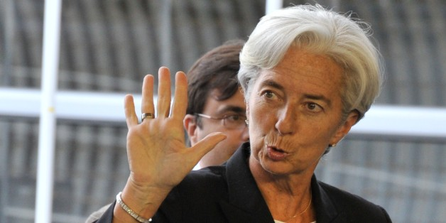 French Finance Minister Christine Lagarde waves as she arrives prior to an Eurogroup meeting on June 19, 2011 at the EU Headquarters in Luxembourg. Lagarde attends a two days of crunch talks to release funds to keep Athens from default in the summer, while mulling the shape of a second bailout for Athens in just over a year. Ministers from the 17 nations using the euro were to begin talks at 7:00 pm (1700 GMT) to approve loans of over 8.7 billion euros ($12.5 billion), their share of a 12-billion-euro tranche of bailout funding which Athens needs to avoid default next month.   AFP PHOTO/ GEORGES GOBET (Photo credit should read GEORGES GOBET/AFP/Getty Images)