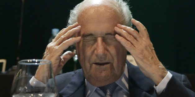 In this Wednesday, March 4, 2015 photo, FIFA President Sepp Blatter closes his eyes as he raises his hands to his temples during a CONMEBOL congress in Asuncion, Paraguay. The 78-year-old Blatter is seeking a fifth, four-year term running football. (AP Photo/Jorge Saenz)