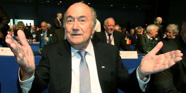 FIFA President Joseph Blatter gestures as he waits for the start of the 39th Ordinary UEFA Congress in Vienna, Austria, Tuesday, March 24, 2015. Blatter hit out at unnamed lawmakers for wanting boycotts of the 2018 World Cup in Russia and the 2022 event in Qatar. (AP Photo/Ronald Zak)