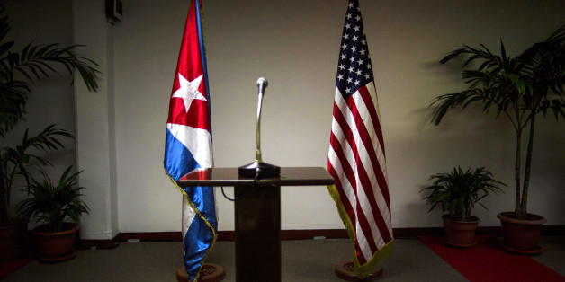 FILE - In this Jan. 22, 2015 file photo, a Cuban and U.S. flag stand before the start of a press conference on the sidelines of talks between the two nations in Havana, Cuba. The U.S. hopes to open an embassy in Havana before presidents Barack Obama and Raul Castro meet at a regional summit in April, which will be the scene of the presidents' first face-to-face meeting since they announced on Dec. 17 that they will re-establish diplomatic relations after a half-century of hostility. (AP Pho