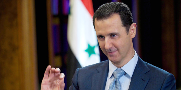 FILE - In this Tuesday, Feb. 10, 2015 file photo released by the Syrian official news agency SANA, Syrian President Bashar Assad gestures during an interview with the BBC, in Damascus, Syria. (AP Photo/SANA, File)