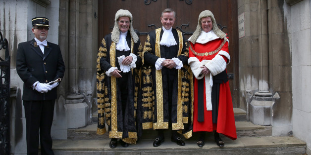 LONDON, ENGLAND - MAY 19:  Michael Gove (2R) stands with Master of the Rolls, Lord Dyson (2L) and The Lord Chief Justice Baron Thomas of Cwmgiedd (R) as he arrives at The Royal Courts of Justice to be sworn in as Lord Chancellor on May 19, 2015 in London, England. Mr Gove replaces Chris Grayling as Lord Chancellor and Justice Secretary in the new government.  (Photo by Peter Macdiarmid/Getty Images)