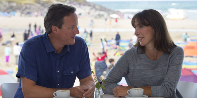 Prime Minister David Cameron with wife Samantha Cameron on Polzeath beach in Cornwall last year. Photo by Matthew Horwood - WPA Pool /Getty Images
