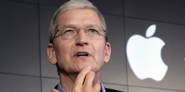 Apple CEO Tim Cook responds to a question during a news conference at IBM Watson headquarters, in New York, Thursday, April 30, 2015. Apple, IBM and Japanese insurance and bank holding company Japan Post have formed a partnership to improve the lives of elderly people in the country. The program will provide iPads with apps designed to help seniors manage day-to-day lives and keep in touch with family members. (AP Photo/Richard Drew)