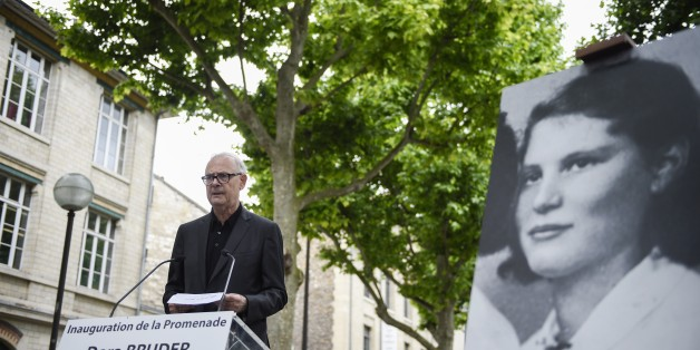 French literature nobel prize writer Patrick Modiano delivers a speech during the inauguration of the street 'Promenade Dora Bruder' on June 1, 2015 in Paris. Dora Bruder was a French Jewish woman who died in the Nazi death camp Auschwitz.  AFP PHOTO / MARTIN BUREAU        (Photo credit should read MARTIN BUREAU/AFP/Getty Images)