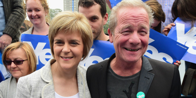 GLASGOW, SCOTLAND - SEPTEMBER 12:  Deputy First Minister Nicola Sturgeon (L) and actor Peter Mullan campaign for the 'Yes' vote in Drumchapel on September 12,2014 in GlasgowScotland. With less than a week to go, the latest polls in Scotland's independence referendum puts the No campaign back in the lead, the first time they have gained ground on the Yes campaign since the start of August.  (Photo by Jeff J Mitchell/Getty Images)