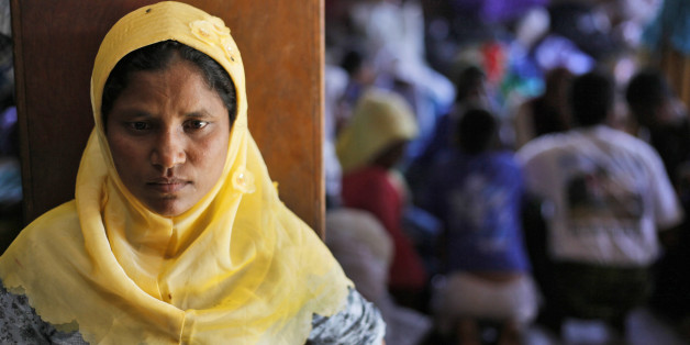 A Rohingya woman stands at a temporary shelter in Bayeun, Aceh Province, Indonesia, Monday, June 1, 2015. Since early May, thousands of boat people from Myanmar and Bangladesh have been brought ashore from Southeast Asian waters. Several thousand more are believed to still be at sea after human smugglers abandoned their boats amid a regional crackdown. (AP Photo/Binsar Bakkara)