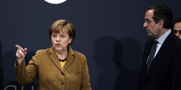 German Chancellor Angela Merkel (L) talks with Greece's Prime minister Antonis Samaras upon their arrival for a meeting with young Greek businessmen in a hotel in Athens on April 11, 2014. Merkel is in Greece on April 11 to applaud reform efforts, a day after the eurozone laggard made a triumphant return to bond markets. In her second visit to Athens in two years, Merkel was expected to discuss Germany's contribution to a 500-million-euro ($690-million) investment fund to help the Greek economy