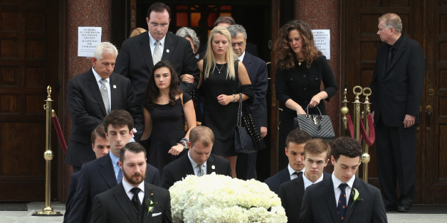 WASHINGTON, DC - JUNE 01:  Surviving daughters Katerina Marie Savopoulos (C) and Abigal Marie Savopoulos (L) folllow behind the casket of their 10-year old brother Philip Savopoulos after a funeral service the Saint Sophia Greek Orthodox Cathedral June 1, 2015 in Washington, DC. The funeral service was held for Savvas Savopoulos, 46, his wife, Amy, 47, and their 10 year old son, Philip who were murdered along with their housekeeper, Veralicia Figueroa, 57, who was killed with them.   Darron Dellon Dennis Wint, was arrested and being held without bond for thier murders. (Photo by Mark Wilson/Getty Images)