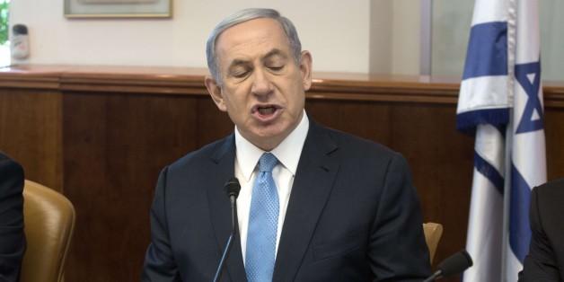 Israeli Prime Minister Benjamin Netanyahu gestures as he chairs the weekly cabinet meeting in Jerusalem on May 31, 2015. AFP PHOTO / POOL / MENAHEM KAHANA        (Photo credit should read MENAHEM KAHANA/AFP/Getty Images)