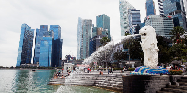 SINGAPORE - MARCH 09:  A view of the Merlion and the Singapore financial district near the Singapore River on March 9, 2015 in Singapore.  (Photo by Scott Halleran/Getty Images)