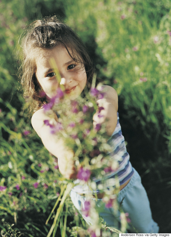 young child giving flowers