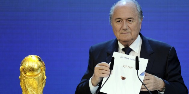 FIFA President Sepp Blatter holds up the name of Qatar during the official announcement of the 2022 World Cup host country. PHILIPPE DESMAZES/AFP/Getty Images