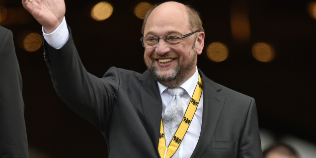 European parliament president Martin Schulz waves after he received the International Charlemagne Prize of Aachen (Karlspreis) in Aachen, Germany, Thursday, May 14, 2015. The International prestigious Charlemagne Prize of Aachen is the oldest and best-known prize awarded for work done in the service of European unification. (AP Photo/Martin Meissner)
