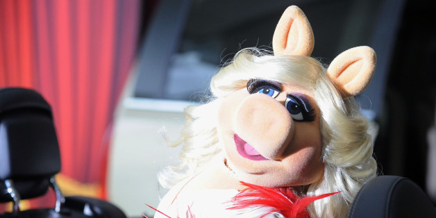 Miss Piggy arrives at the premiere of  The Muppets at El Capitan Theater, Saturday, Nov. 12, 2011, in Los Angeles.  The Muppets opens in theaters Nov. 23, 2011. (AP Photo/Katy Winn)