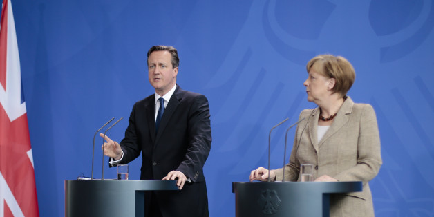 German Chancellor Angela Merkel, right, and British Prime Minister David Cameron  (AP Photo/Markus Schreiber)