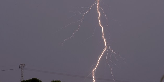 A lightning is seen on June 11, 2014 over Schkeuditz, Germany.  AFP PHOTO / HENDRIK SCHMIDT        (Photo credit should read HENDRIK SCHMIDT/AFP/Getty Images)