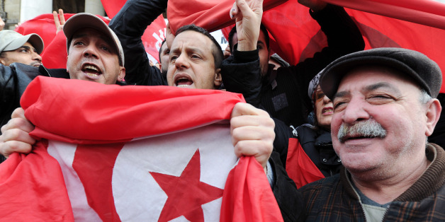 Tunisians living in Belgium protest against Tunisia's President Zine Abidine El Ben Ali at the Brussels' stock market, Saturday Jan. 15, 2011. Tunisia  has been grappling with looting, deadly fires and widespread unrest after protests forced President Zine El Abidine Ben Ali to flee to Saudi Arabia on Friday. (AP Photo/Geert Vanden Wijngaert)
