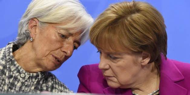 (From L) International Monetary Fund Managing Director Christine Lagarde and German Chancellor Angela Merkel address a press conference after talks at the chancellery in Berlin on March 11, 2015. AFP PHOTO / TOBIAS SCHWARZ        (Photo credit should read TOBIAS SCHWARZ/AFP/Getty Images)