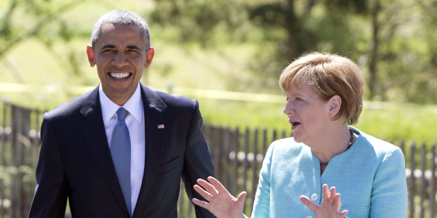 US President Barack Obama and German Chancellor Angela Merkel walk together as the president arrives in Kruen, near Garmisch-Partenkirchen, southern Germany, Sunday, June 7, 2015, before attending the G-7 summit in Schloss Elmau hotel. (AP Photo/Carolyn Kaster)