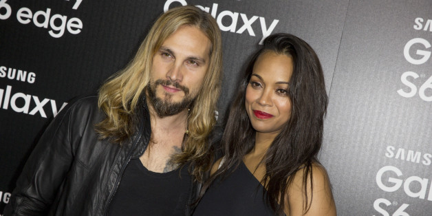 Marco Perego, left, and Zoe Saldana arrive at the Launch Of The Samsung Galaxy S6 And The Galaxy S6 Edge at Quixote Studios on Thursday, April 2, 2015,  in West Hollywood, Calif. (Photo by Rich Fury/Invision/AP)