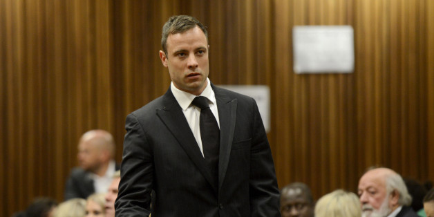 BY COURT ORDER, THIS IMAGE IS FREE TO USE.   PRETORIA, SOUTH AFRICA - OCTOBER 21 (SOUTH AFRICA OUT): Oscar Pistorius arrives in the Pretoria High Court  for sentencing in his murder trial on October 21, 2014, in Pretoria, South Africa. Judge Thokozile Masipa will hand down her sentence today in the Oscar Pistorius murder  trial. She found Pistorius not guilty of murdering his girlfriend Reeva Steenkamp, but convicted him of culpable homicide. (Photo by Herman Verwey/Foto24/Gallo Images/Getty Images)